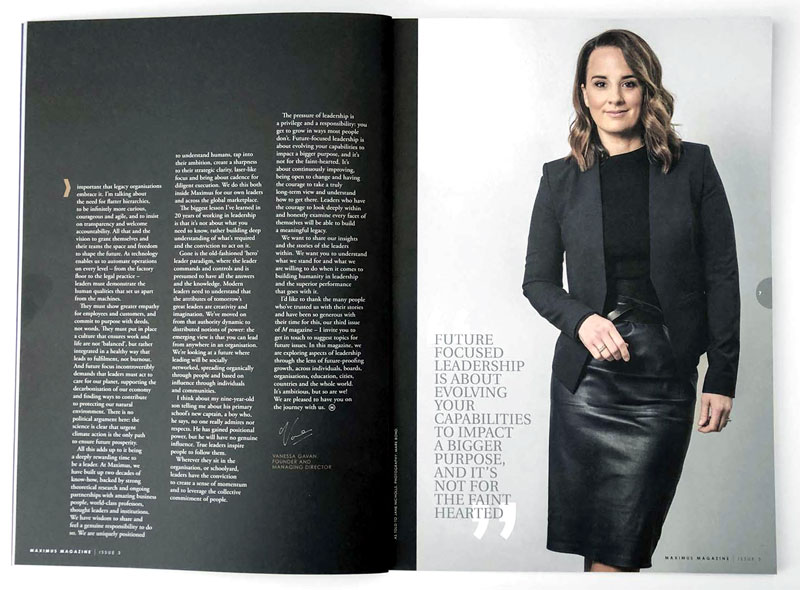 Vanessa Gavan's profile picture shown in the pages of a magazine. Vanessa is wearing all black against a white wall on opne page and the other page is white text on a black background.
