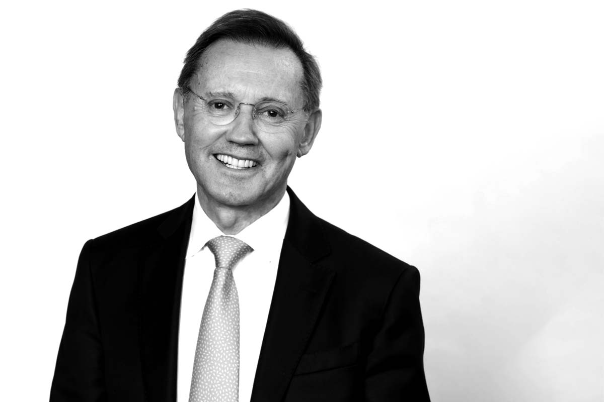 Anthony in Black and white wearing a smart suit a tie for his corporate headshot