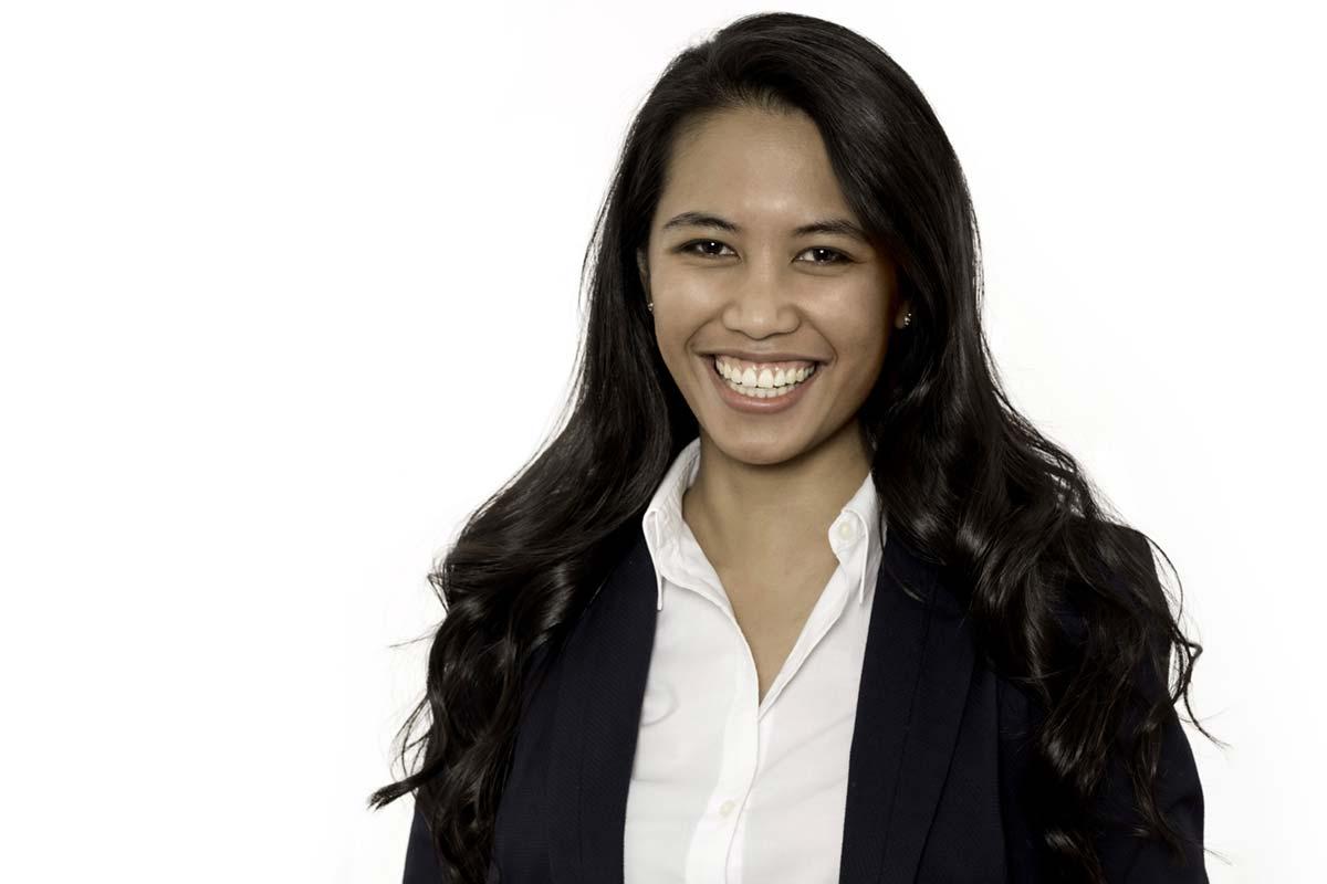 Jacqueline in a jacket a shirt professional smiling headshot image